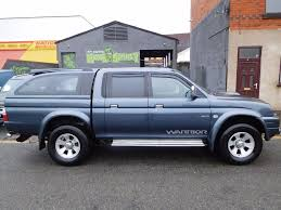mitsubishi l200 warrior 4x4 2005 with load liner and rear canopy