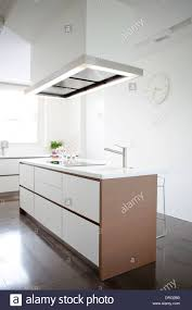 modern kitchen stove modern kitchen island with induction stove and sink stock photo