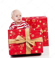 christmas baby boy with gift box baby is sitting u2014 stock photo