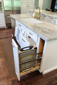 best 25 kitchen island sink ideas on pinterest kitchen island this kitchen has a gray marble top central island with easy pull out drawers for kitchen tools and essentials