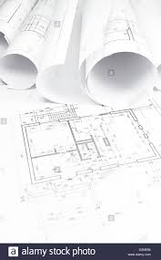 Architectural Building Plans by Architectural Blueprint With Bunch Of Rolled Up Building Plans