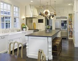 gourmet kitchen islands two kitchen islands unified with brass lanterns transitional