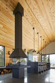 cathedral ceiling kitchen lighting ideas expansive quebec residence charms with inviting warmth of wood