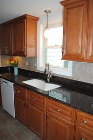 vinyl kitchen backsplash maple cabinets brown granite tile backsplash vinyl floors