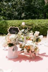 assorted milk glass table centerpiece by peddles florist with