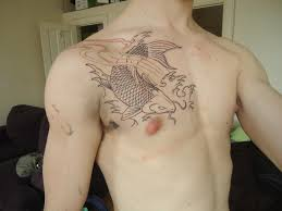 outline of my koi fish on chest designed inked by