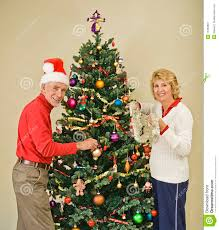 happy senior decorating tree royalty free stock