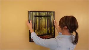 Picture Frame On Wall by How To Hang A Picture Frame Level U0026 Straight On The Wall Youtube