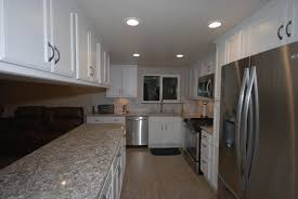 starmark white cabinets with cambria bellingham and stainless