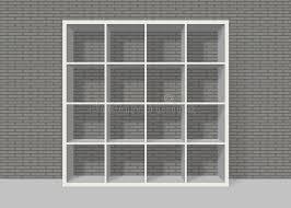 Bookshelf Background Image White Empty Square Bookshelf On Grey Brick Wall Background Royalty