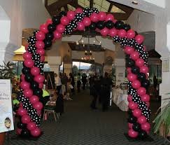 black and white polka dot and pink balloon arch barbie