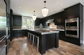 colored kitchen cabinets with black countertops black accents in kitchen kitchen trends black countertops