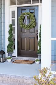 front porch decor and a little blue house boxwood wreath and