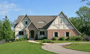 what makes a house a tudor ask maria should my roof go black on my tudor home maria killam