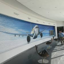 embraer engineering tech center opens in melbourne mural