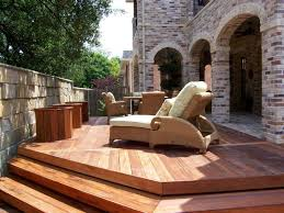 small decks with cozy wooden seating with mattress for comfy