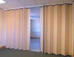cream alumunium sliding room divider connected by grey carpet of