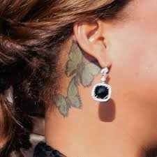 queen latifah butterfly neck tattoo steal her style