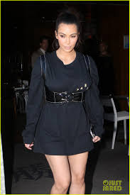 kim kardashian turns an over sized shirt into a dress photo