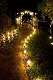 backyard curve rockwall earth patio swing landscape lighting