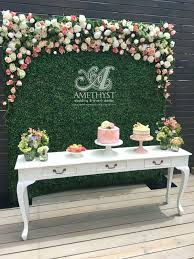 dessert table backdrop picture of boxwood flower wall for a dessert table backdrop