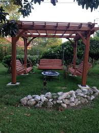 great outdoor area with pergola swings and fire pit outside