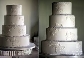 elegant white wedding cake with fondant lace appliques and strings