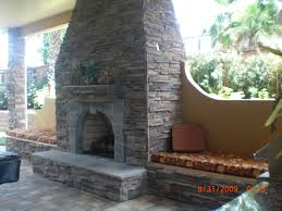 archaic outdoor kitchen with fireplace with bricks stone outdoor