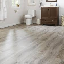 can you put vinyl plank flooring cabinets sterling oak 8 7 in w x 47 6 in l luxury vinyl plank flooring 20 06 sq ft