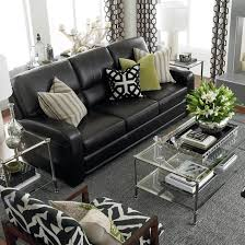 living room black leather couches med art home design posters
