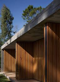 slatted timber doors unfold along house in uruguay by masa