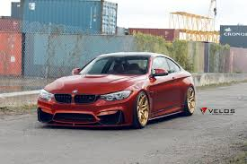 stanced bmw m4 we can u0027t take our eyes off this bmw m4 with a sakhir orange finish