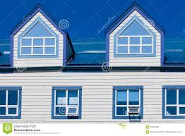 wooden frame house blue metal roof dormer windows stock photo