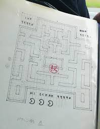 pac man creator shows off graph paper with original game design