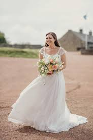 a naomi neoh dress for a flower filled barn wedding love my