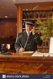 portier front desk of hotel hermitage breuil cervinia stock