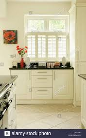 Kitchen Window Shutters Interior White Plantation Shutters On Window In Modern White Kitchen With
