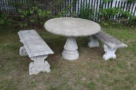 stone pedestal table and two stone benches