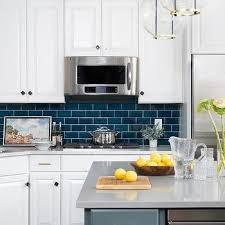 white kitchen cabinets with blue tiles blue subway tiles with white cabinets blue