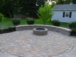 paver patio with wood burning fire pit completed hardscape