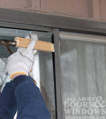 How To Install A Patio Door by How To Replace Rollers In Aluminum Sliding Glass Doors