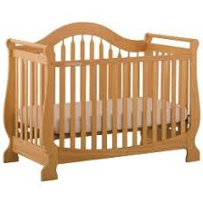 would a natural oak colored crib dresser set look ok with this