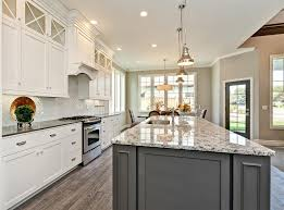 white kitchen cabinetry with grey accent island chrome hardware