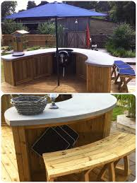 outdoor bbq kitchen built in weber grill and charcoal wok with a