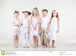 four and one boy in white clothes stand royalty free