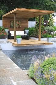 wohnideen minimalistischem pergola outdoor swimming pool shade ideas wooden pergola sunbeds patio