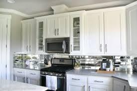 Brushed Nickel Backsplash by Elegant Kitchen Decor With White Reveal Mirrored Kitchen Cabinet