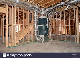 the newly framed basement area of a house the central heat and