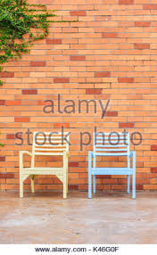 brick wall with chairs and ornamental stock photo royalty