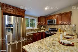 what to do with brown kitchen cabinets brown kitchen design with mahogany kitchen cabinets stock photo image now